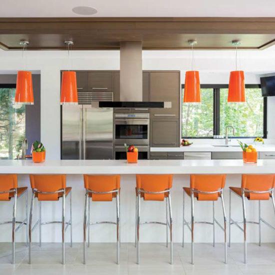 Modern kitchen with orange accents